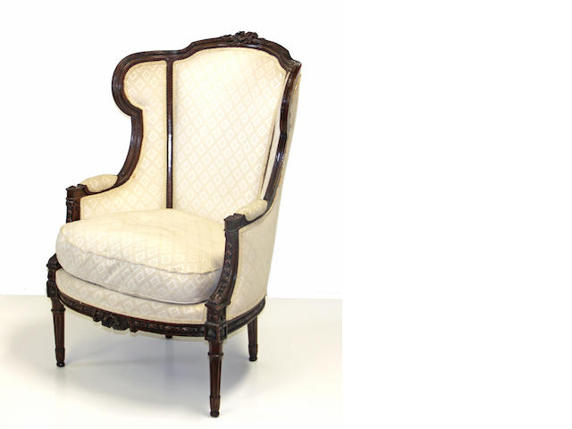 A Louis XVI style walnut upholstered bergère late 19th century
