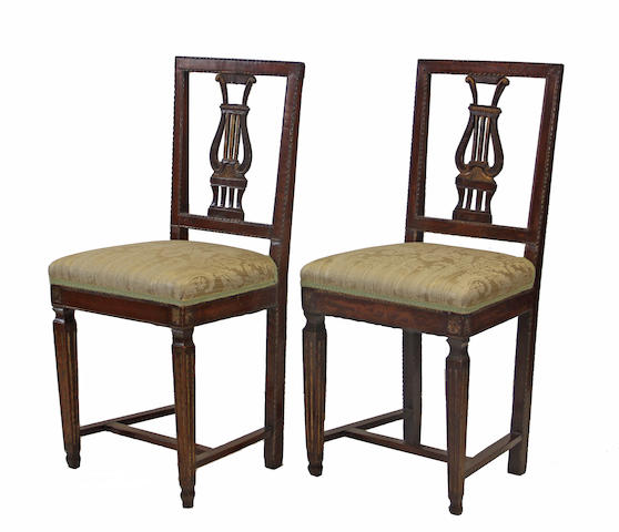 A pair of Italian Neoclassical parcel gilt walnut chairs late 18th century