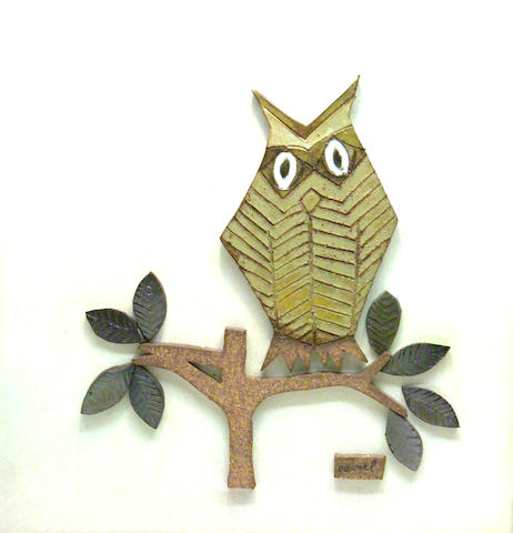 A stoneware picture of an owl Raul Coronel