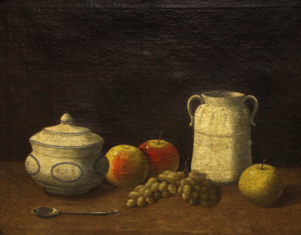Follower of George Smith of Chichester (Chichester 1714-1776) A still life with apples, grapes and crockery 20 x 25 1/4in
