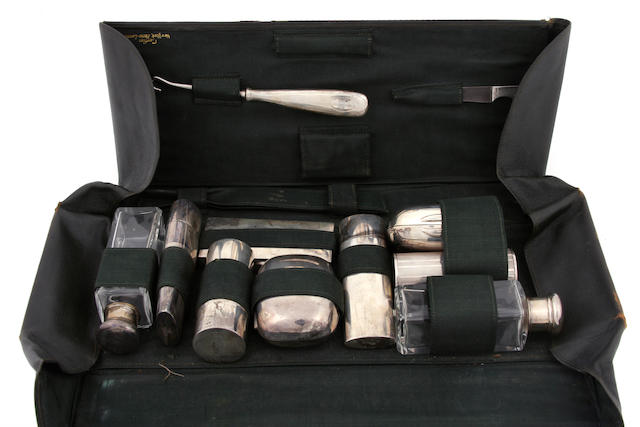 An assembled sterling silver and glass cased gentleman's travel part vanity set 20th century