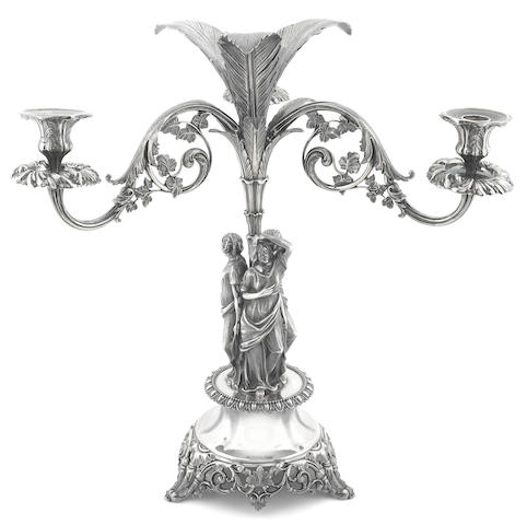 A Victorian electroplated nickle silver figural tripod centerpiece with three candle branches James Dixon & Sons, Sheffield