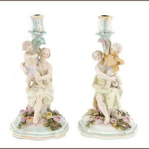 A pair of Sitzendorf porcelain figural candlesticks