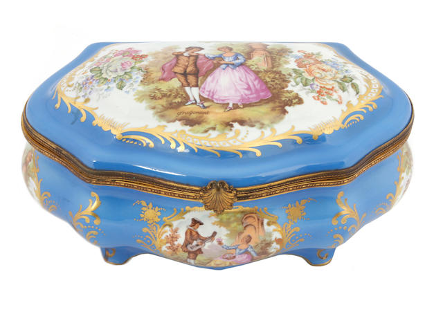 A Sèvres style gilt metal mounted porcelain table casket