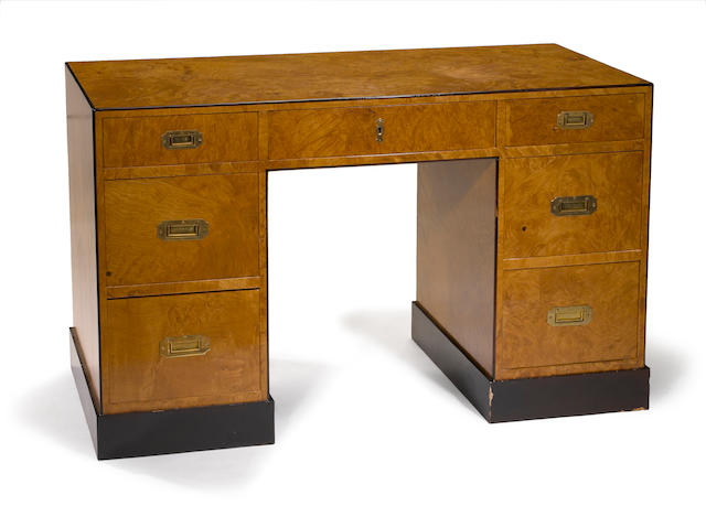 A contemporary burlwood kneehole desk