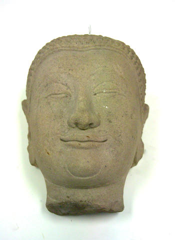 A Thai stone fragment of a head of a Buddha