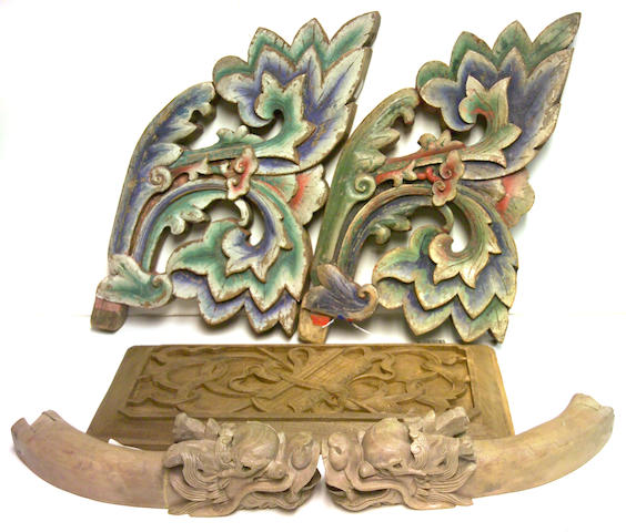 A group of five carved Asian wooden architectural fragments