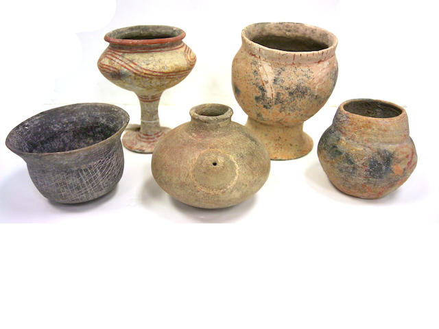 Group of five Asian pottery vessels