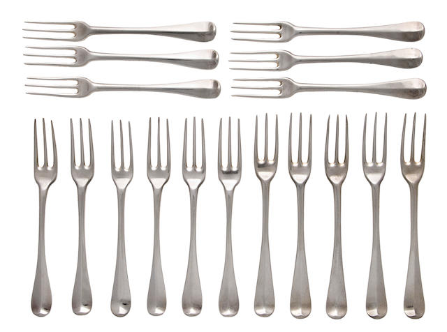Seventeen sterling silver three pronged George I dinner forks