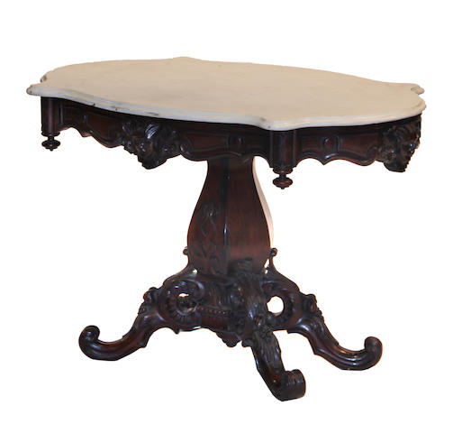 A Rococco Revival rosewood center table mid 19th century