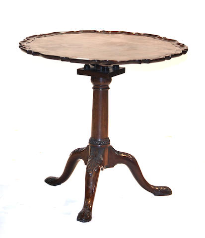 A George III mahogany pie crust tilt top tea table