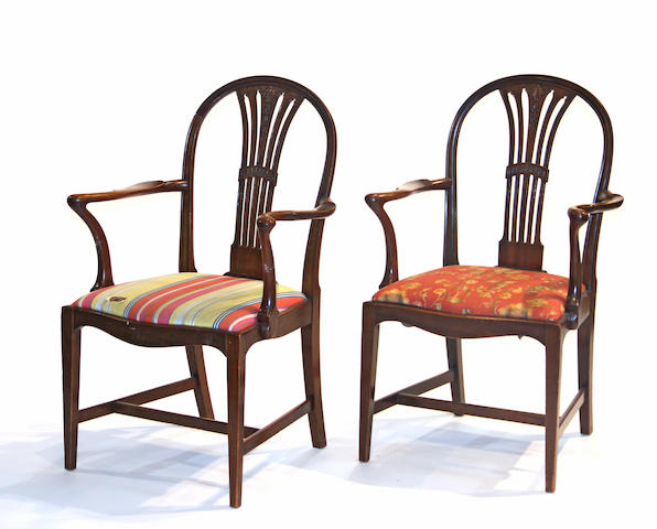 A pair of George III style carved mahogany armchairs late 19th/early 20th century