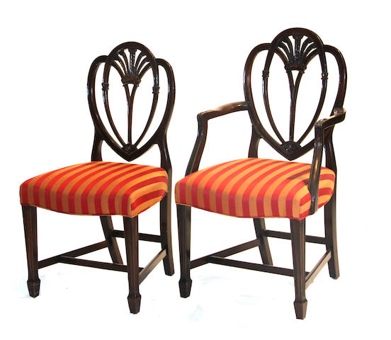 A set of twelve George III style mahogany shield back dinging chairs