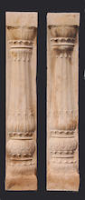 A pair of Classical style stone pilasters