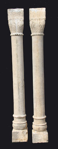 A pair of Classical style stone columns