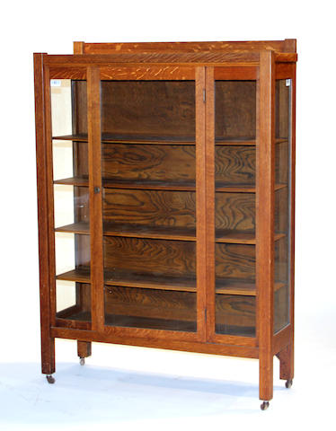 An Arts & Crafts oak bookcase