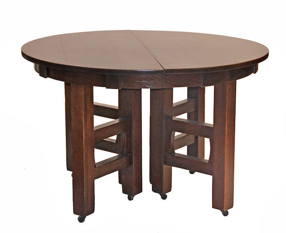 An Arts & Crafts oak extension dining table