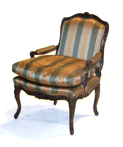 A pair of Louis XV style walnut fauteuils