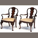 A pair of early Georgian style walnut armchair  20th century