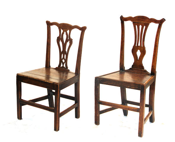 Four George III elmwood and fruitwood plank seat side chairs fourth quarter 18th century