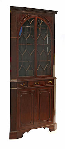 A George III style mahogany corner cupboard late 19th/early 20th century