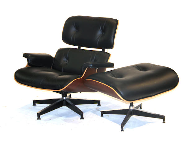 A Herman Miller Eames cherry and leather lounge chair and ottoman 20th century