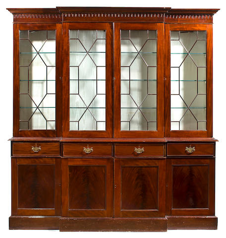 A George III style mahogany breakfront bookcase 20th century