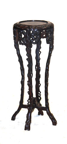 A Chinese circular wood plant stand Late Qing/Republic period