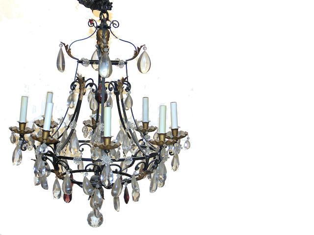 A Rococo style patinated metal and cut glass eight light chandelier 20th century