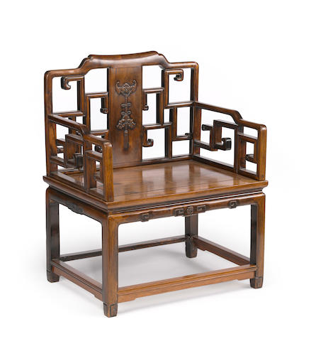 A hardwood arm chair 20th Century