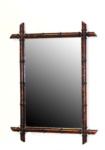 A pair of faux tortoise framed mirrors