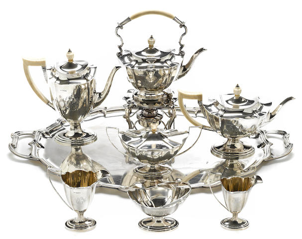 A George V silver and ivory five piece tea and coffee set with complementary tray Mappin & Webb, Sheffield, 1926, retailed by Mappin & Webb, Ltd., Sheffield and London <BR />Monogrammed: CCM  (9)