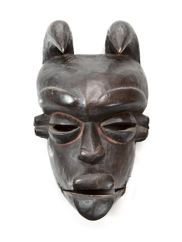 Mask. Ibibio, Nigeria. Black mask with two horns projecting forward from the back of the head over the forehead.
