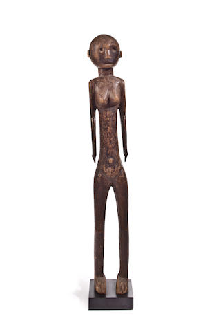 Carved female figure