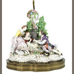 A large Continental porcelain pastoral figural group now mounted as a lamp