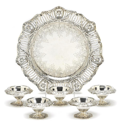 A sterling partial table suite Graff, Washbourne & Dunn, New York, NY, some retailed by Tiffany & Co. <BR />French Border, #s 2925 (plate), 5359/46 (cellars)  (6)