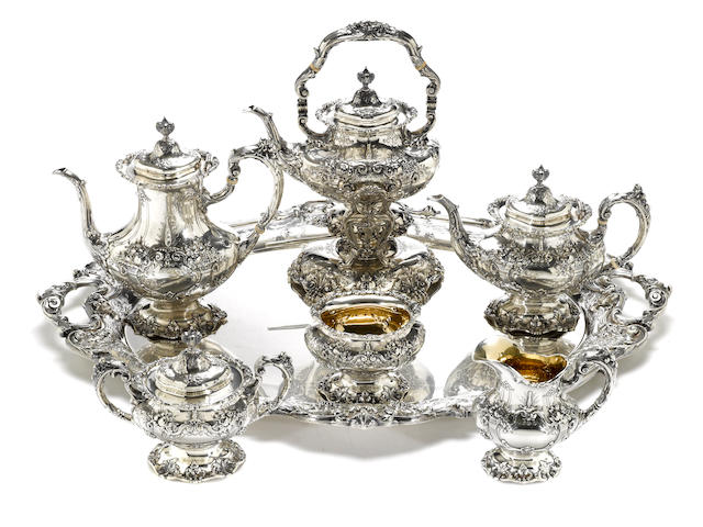 A sterling six piece tea and coffee set with matching tray, all hand chased Reed & Barton, Taunton, MA, second half 20th century  Francis I, #s 570A (set) 752A (tray)  (7)