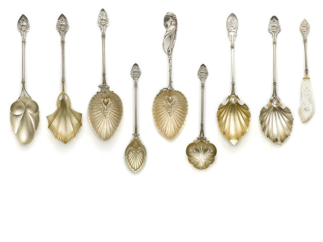 A parcel gilt sterling assembled collection of flatware serving pieces Without maker's mark (Whiting Mfg. Co., Providence, RI), circa 1860-1880 <BR />In three patterns, some with (various) engraved period monograms on verso's  (9)