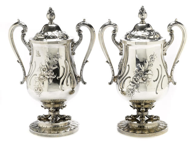 A sterling pair of urns with covers S. Kirk & Son Inc., Baltimore, MD, circa 1925-1932  <BR /># 3379, with crest  (2)