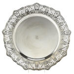 A sterling circular tray (Graff, Washbourne & Dunn, New York, NY), retailed by Tiffany & Co. <BR />French Border, # 5383/46, with crest