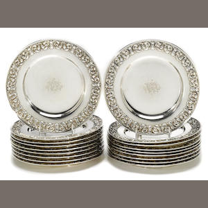 A set of eighteen American sterling silver  place plates Tiffany & Co., New York, NY,  circa 1907-1947  ( )