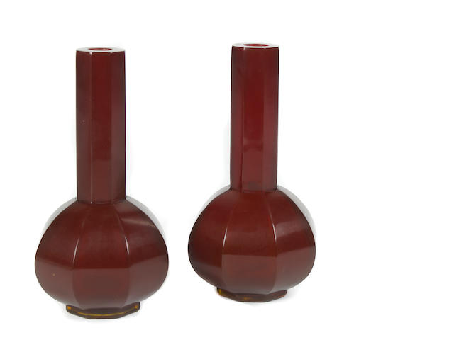 A pair of red Peking glass vases