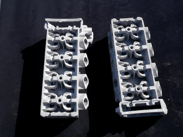 A pair of Aston Martin V8 cylinder heads,