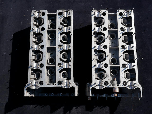 Three original Aston Martin V8 cylinder heads,