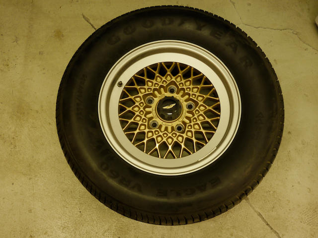 "A set of four 7x15"" AM V8 wheels and tyres,"