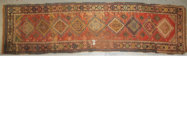 A Kurd Kazak runner  size approximately 3ft. 8in. x 13ft. 4in.