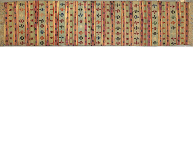 A Kilim size approximately 2ft. 3in. x 9ft. 4in.