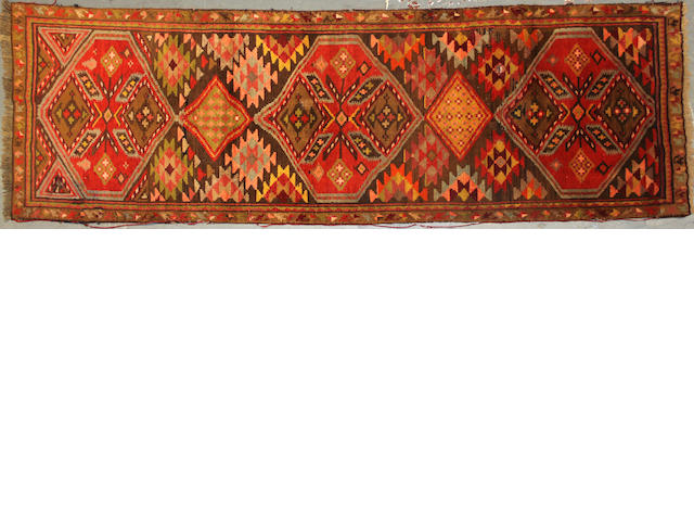 A Kurdish runner size approximately 3ft. x 8ft. 8in.