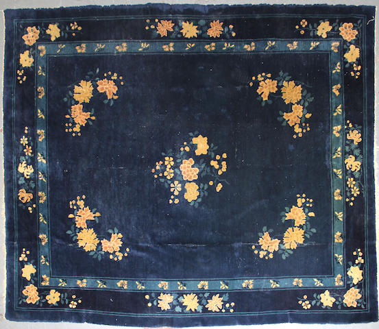 A Chinese carpet size approximately 8ft. x 9ft. 6in. size approximately 8ft. x 9ft. 6in.