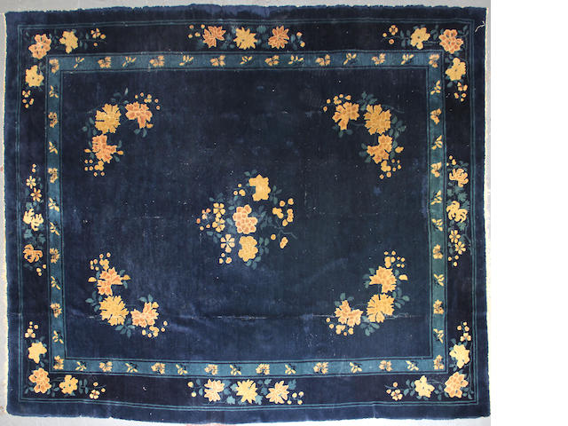 A Chinese carpet size approximately 8ft. x 9ft. 6in.